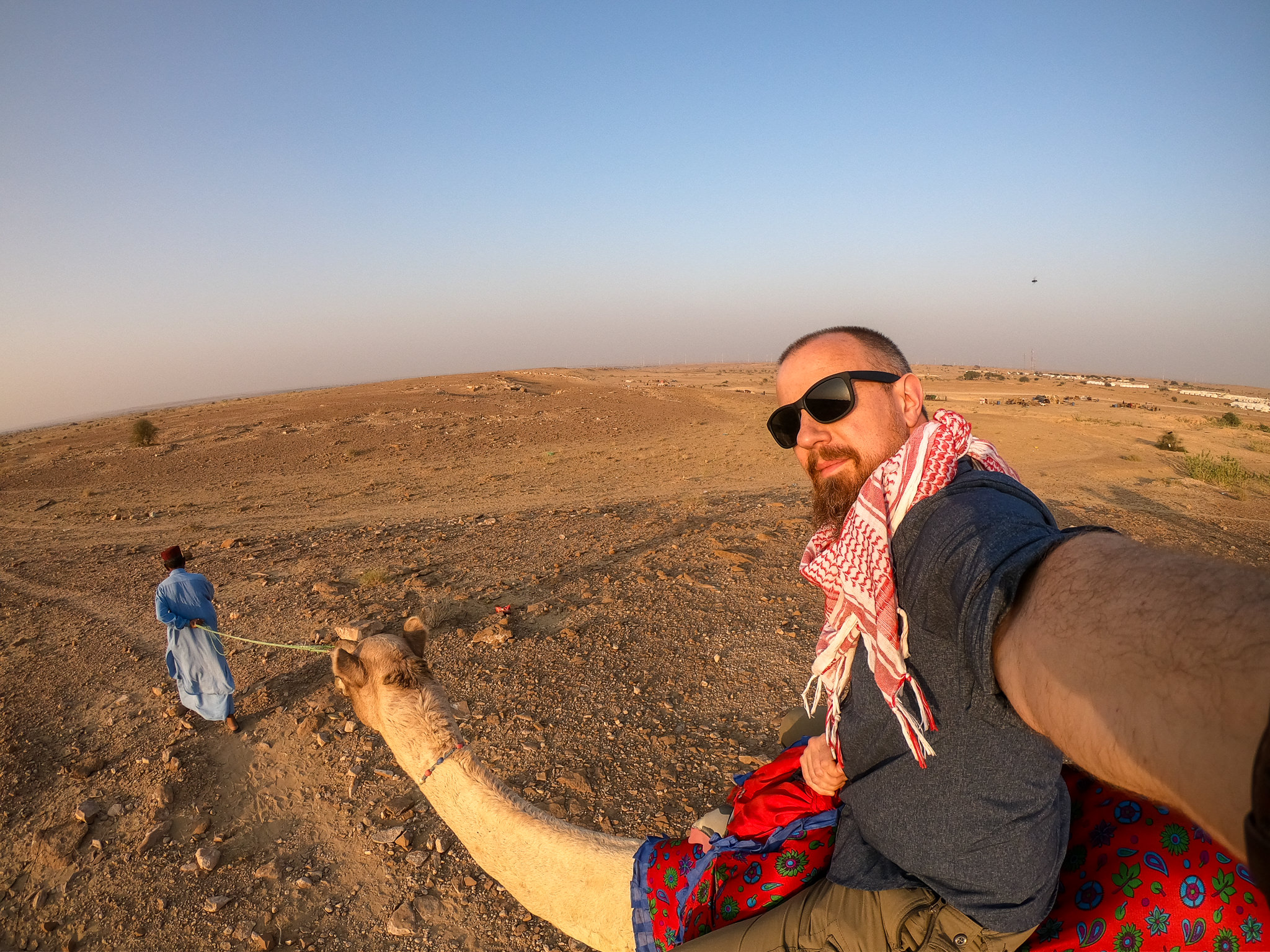 Your host, PhotoJoseph, braving a camel ride! It kinda hurts… but it's totally worth it!