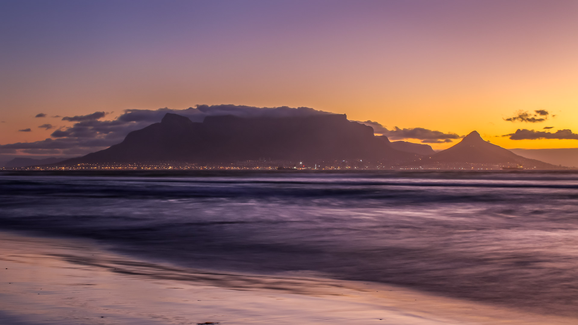 Golden hour sunset over table mountain in Cape Town, South Africa